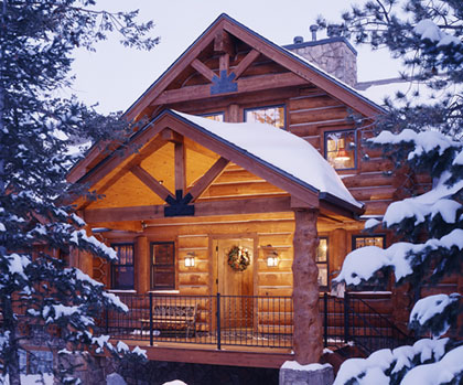 Front entry of snow covered cabin