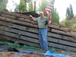 1808 Bob Timberlake | Waving flag in front of logs