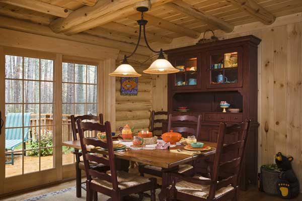 Lakeside log home dining area with view