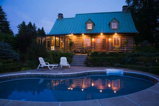 Quebec Log Home Exterior with Pool