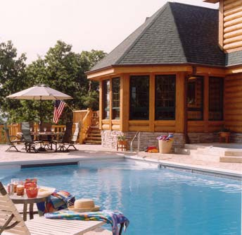 Pool by Home | Wisconsin Log Homes Photo
