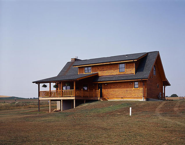 Log Home in a Field