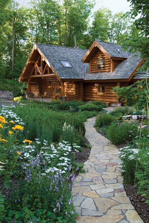 Stone Walkway Leading to a Log Cabin Home