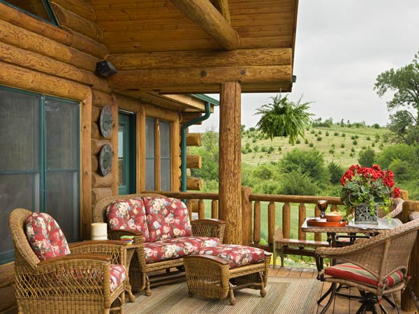 Photos of a rustic log home midwest paradiso for Log home decks