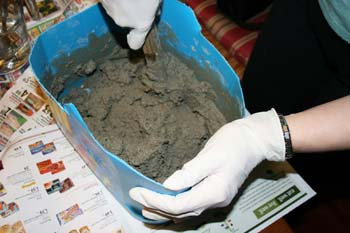 Mixing Concrete in a Bucket at Home