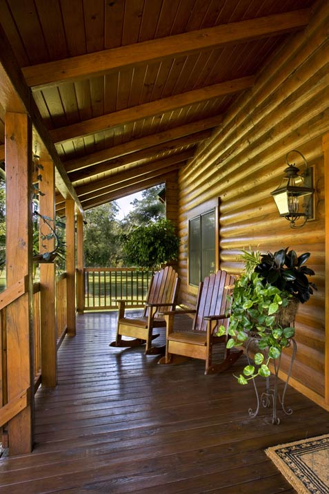 Photos of a florida log home sunshine state of mind for Log homes with wrap around porch
