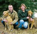 couple with golden retrievers