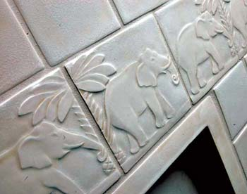 Carved White Tile with Elephants Marching