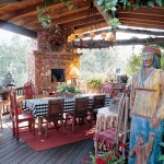 From the old deck sprang a ramada anchored by a large gas and wood-burning fireplace made from native red rock.