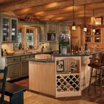 The kitchen design is all rustic with moss green-stained cabinets graced with iron hardware, red Italian ceramic tile floors and two antique cupboards.