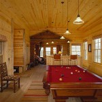 """If we really want to get away, we go to the cabin,"" says Nancy. A pool table provides lively entertainment."