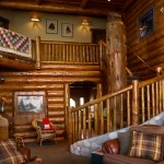 A sweeping lodgepole-pine staircase with native river-rock accents rises to the second floor. A copper grab rail got its patina after being left outside in the elements for years. Wall-to-wall Mohawk carpeting gives a plush look and feel underfoot.