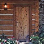 Rustic wooden side door to the log cabin