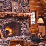 Cozy great room with roaring fireplace and stone hearth