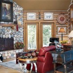 Cozy sitting room, warmed by stone fireplace