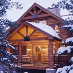 Colorado Mountain Log Home Tour: Front entry of snow covered cabin.
