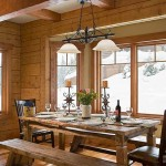 Rustic elegance envelops the log home's dining area, and the authentic wood dining room table offers a warm welcome to hungry guests.