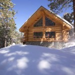 Log cabin lodge in the winter