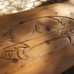 Hand-carved picnic table at the log cabin