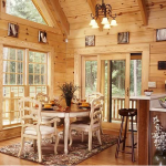 "Friends and family can gather in the kitchen/dining area and enjoy the expansive use of windows at the same time. A walk through the rolling French doors leads to the deck. ""You can get enamored by the great outdoors in this space,"" Steve says."
