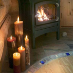 Log cabin hearth and natural candles