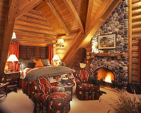Nothing says luxury like a roaring fire in a bedroom hearth.