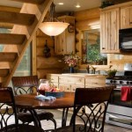 Hickory cabinets line the warm and welcoming kitchen. Although the couple dines here often, their favorite place to eat is outside by the grill.