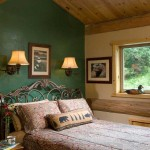 To break up the home's ample wood, Jim and Christine incorporated drywall (painted in vivid colors, such as this forest-green bedroom wall) throughout the home. Jim's many hobbies include carving and painting duck decoys, one of which is perched on the windowsill.