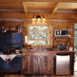 A small kitchenette in the cabin with an antique Hoosier cabinet.