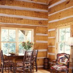 A small dining area off the cabin's great room overlooks the covered porch.