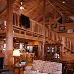 "The Cioffis use a mixture of chandelier and track lighting. Light fixtures from the vaulted ceilings provide ambient lighting while track lighting is task-oriented. ""It's a mix you seldom see but in log homes, it goes well together,"" says Joseph."