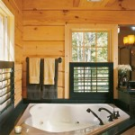 "For their master bathroom, the Seilers chose a deep soaker tub and separate shower in lieu of a large master walk-in closet. The wide shuttered wood blinds have a chunkier look that's consistent with the rest of the house. ""I like their cottagey, old-fashioned feel,"" Fran says."