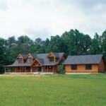 With a wraparound porch and awe-inspiring trusses, the Hecker family home is the epitome of log-home living.
