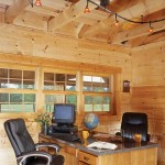 A large home office was important to the Heckers, who own there own business. The office has an open-beamed ceiling to allow light from the dormer window and allow the dramatic cathedral ceiling to be seen.