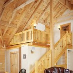 The handmade open stairway is made from squared-off light-colored timbers to blend with the rest of the home.