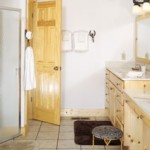 The bathroom retains clean white color and breaks from the rustic looks in the rest of the home