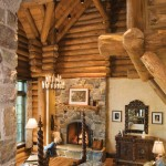 A stone tower rises through the middle of the south guest cabin, with an arched stone entranceway that offers a view of the lower level bedroom. This cabin was inspired by Bavarian architecture style.