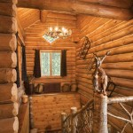 The Honeymoon Cabin's entrance is on the upper level, with a yellow birch twig stairway leading to the second bedroom on the lower level.