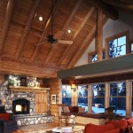 The great room has a breathtaking wall of windows and a cathedral ceiling, but the main focus is the Cultured Stone fireplace.