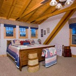 "The master suite boasts a 14-foot cathedral ceiling, a large walk-in closet and plenty of windows to let the outside in. Top-quality white-and-tan Berber carpet warms up the space. ""We installed drywall and wallpapered this room to show clients that they have options other than wood,"" Sharon says."