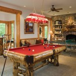 The lower level features this bright game room for entertainment