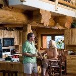 Steve and Janna Lankford love their open kitchen that allows easy interaction between the food-prep areas and the great room. Tall chairs and stools add to the casual dining atmosphere.