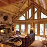 Debbie, an avid nature-lover, wanted to be able to connect with the outdoors even when inside. To achieve this, she designed the great room with three sets of glass-paned French doors and rafter-high windows.