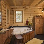 The master bath features a whirlpool bath with a view of the woods.