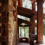 The Oughs insisted that their house reflect the natural environment—from the native stone to the heavy, hand-hewn timbers. As a result, a sense of warmth and comfort permeates both indoor and outdoor spaces.