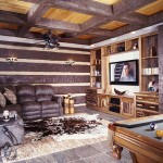 The Oughs spared no detail, even in the basement media area. Two kinds of wood create a rustic coffered ceiling, while a variety of fabrics, slate flooring and custom cabinetry add visual appeal.