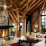 Matt and Clare Tiffin love the way the timber frame's braces mimic tree branches in the great room. Matt selected rock and stone from Colorado, Arkansas and Oklahoma to complement the post and beam home's natural interior.