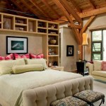 Designed by Hamill Creek Timber Homes, the master bedroom and bath feature a built-in wood wall unit, high-end fixtures and the same exposed ceiling elements seen throughout the home.