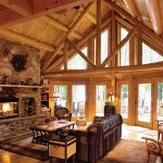 A massive stone fireplace with built-in firewood storage anchors the great room. Sunlight flows from the windows and glass doors in the prow front of the great room all the way through to the back, transforming the cabin into a cheerful retreat.