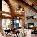 Classic and timeless, this great room is balanced with contrasting colors, layered textures and glorious lake views. Hand-peeled log walls and ceiling beams, a laser-cut elk chandelier and a natural stone fireplace bring rustic spirit to the space.